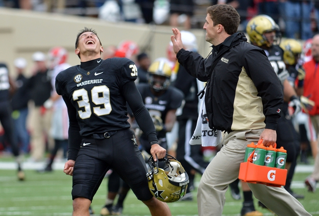 Oct 19, 2013; Nashville, TN, USA; Vanderbilt Commodores kicker Casey Spear (39) celebrates after defeating the Georgia Bulldogs at Vanderbilt Stadium. The Commodores beat the Bulldogs 31-27. Mandatory Credit: Don McPeak-USA TODAY Sports