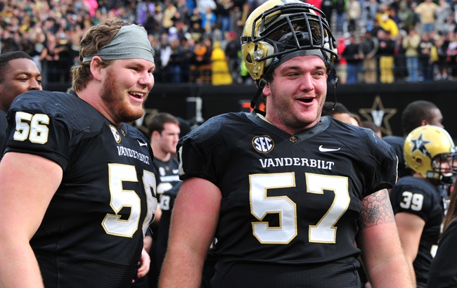 Oct 19, 2013; Nashville, TN, USA; Vanderbilt Commodores center Joe Townsend (57) and lineman Barrett Gouger (56) celebrate after defeating the Georgia Bulldogs at Vanderbilt Stadium. The Commodores beat the Bulldogs 31-27. Mandatory Credit: Don McPeak-USA TODAY Sports