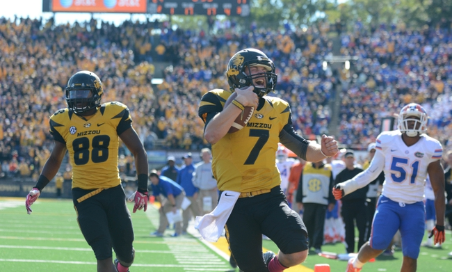 Oct 19, 2013; Columbia, MO, USA; Missouri Tigers quarterback Maty Mauk (7) runs in for a touchdown as Florida Gators linebacker Michael Taylor (51) attempts the tackle during the second half at Faurot Field. Missouri won 36-17. Mandatory Credit: Denny Medley-USA TODAY Sports