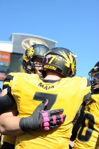 Oct 19, 2013; Columbia, MO, USA; Missouri Tigers quarterback Maty Mauk (7) is congratulated by team mates after scoring a touchdown during the second half of the game against the Florida Gators at Faurot Field. Missouri won 36-17. Mandatory Credit: Denny Medley-USA TODAY Sports
