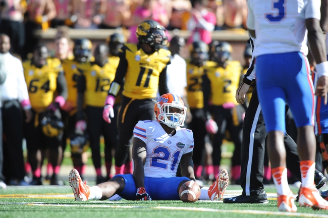 Oct 19, 2013; Columbia, MO, USA; Florida Gators running back Kelvin Taylor (21) reacts after dropping a pass during the second half of the game against the Missouri Tigers at Faurot Field. Missouri won 36-17. Mandatory Credit: Denny Medley-USA TODAY Sports