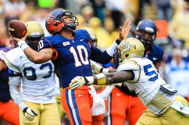 Oct 19, 2013; Atlanta, GA, USA; Syracuse Orange quarterback Terrel Hunt (10) is hit as he throws by Georgia Tech Yellow Jackets linebacker Quayshawn Nealy (54) in the first half at Bobby Dodd Stadium. Mandatory Credit: Daniel Shirey-USA TODAY Sports