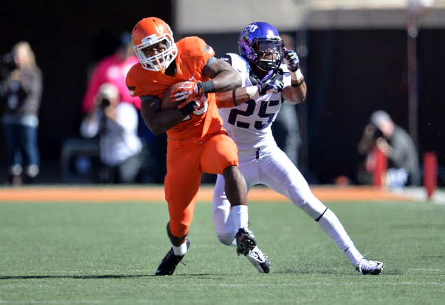 Oct 19, 2013; Stillwater, OK, USA; Oklahoma State Cowboys running back Rennie Childs (23) breaks away from Texas Christian Horned Frogs defensive back Kevin White (25) during the second half at Boone Pickens Stadium. Oklahoma State won 24-10. Mandatory Credit: Peter G. Aiken-USA TODAY Sports