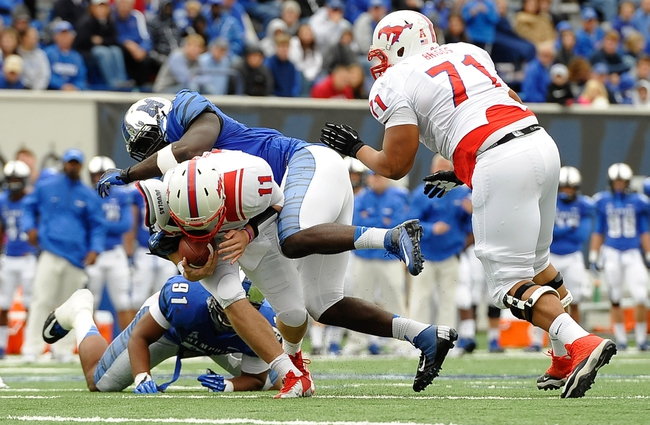 Oct 19, 2013; Memphis, TN, USA; Southern Methodist Mustangs quarterback Garrett Gilbert (11) is sacked by Memphis Tigers defensive lineman Martin Ifedi (97) during the third quarter at Liberty Bowl Memorial. Southern Methodist Mustangs defeats Memphis Tigers 34 - 29. Mandatory Credit: Justin Ford-USA TODAY Sports