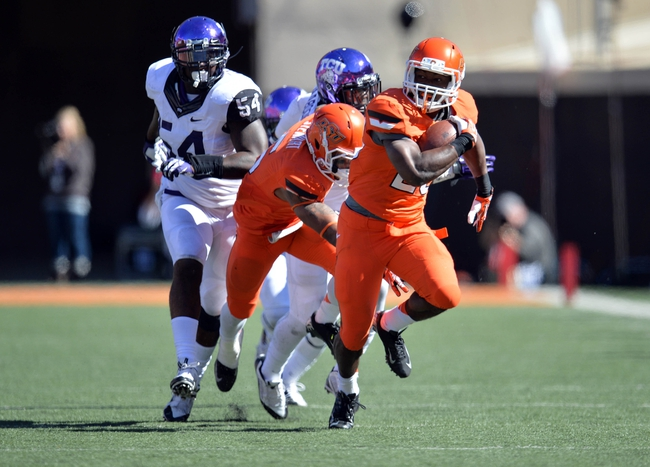 Oct 19, 2013; Stillwater, OK, USA; Oklahoma State Cowboys running back Rennie Childs (23) rushes up field against the Texas Christian Horned Frogs during the second half at Boone Pickens Stadium. Oklahoma State won 24-10. Mandatory Credit: Peter G. Aiken-USA TODAY Sports