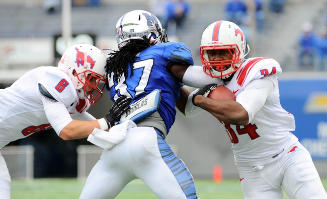 Oct 19, 2013; Memphis, TN, USA; Memphis Tigers defensive back Bakari Hollier (37) chases Southern Methodist Mustangs running back Traylon Shead (34) during the fourth quarter at Liberty Bowl Memorial. Southern Methodist Mustangs defeats Memphis Tigers 34 - 29. Mandatory Credit: Justin Ford-USA TODAY Sports