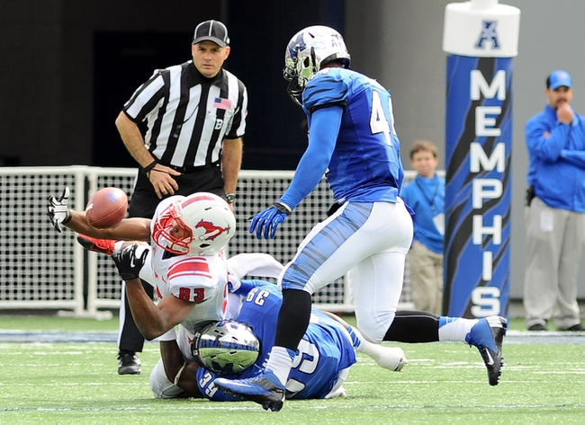 Oct 19, 2013; Memphis, TN, USA; Southern Methodist Mustangs wide receiver JaBryce Taylor (83) fumbles the ball after being tackled by Memphis Tigers defensive back Reggis Ball (39) during the fourth quarter at Liberty Bowl Memorial. Southern Methodist Mustangs defeats Memphis Tigers 34 - 29. Mandatory Credit: Justin Ford-USA TODAY Sports