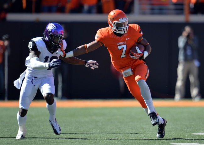 Oct 19, 2013; Stillwater, OK, USA; Oklahoma State Cowboys wide receiver Brandon Sheperd (7) retunes a kick-off against Texas Christian Horned Frogs defender Keivon Gamble (16) during the second half at Boone Pickens Stadium. Oklahoma State won 24-10. Mandatory Credit: Peter G. Aiken-USA TODAY Sports