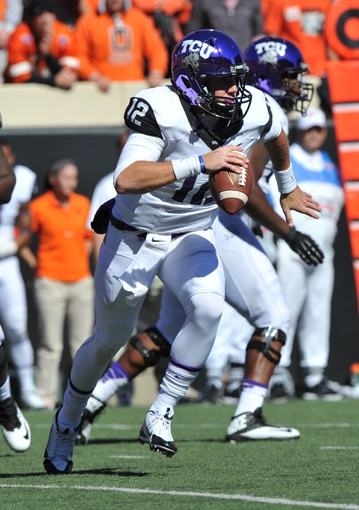 Oct 19, 2013; Stillwater, OK, USA; Texas Christian Horned Frogs quarterback Tler Matthews (12) scrambles to the outside against the Oklahoma State Cowboys during the first half at Boone Pickens Stadium. Oklahoma State won 24-10. Mandatory Credit: Peter G. Aiken-USA TODAY Sports