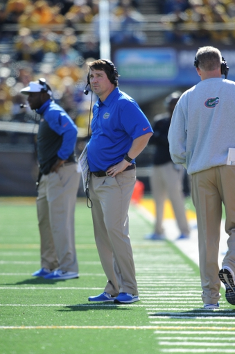 Oct 19, 2013; Columbia, MO, USA; Florida Gators head coach Will Muschamp watches play on the sidelines during the second half of the game against the Missouri Tigers at Faurot Field. Missouri won 36-17. Mandatory Credit: Denny Medley-USA TODAY Sports