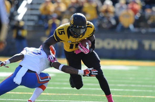 Oct 19, 2013; Columbia, MO, USA; Missouri Tigers wide receiver Dorial Green-Beckham (15) catches a pass and is tackled by Florida Gators defensive back Marcus Roberson (5) during the second half at Faurot Field. Missouri won 36-17. Mandatory Credit: Denny Medley-USA TODAY Sports