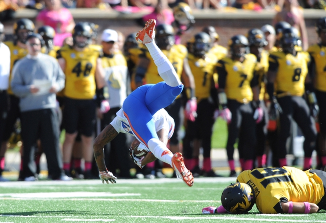 Oct 19, 2013; Columbia, MO, USA; Florida Gators wide receiver Solomon Patton (83) is upended by Missouri Tigers return team member Levi Copelin (16) during the second half at Faurot Field. Missouri won 36-17. Mandatory Credit: Denny Medley-USA TODAY Sports
