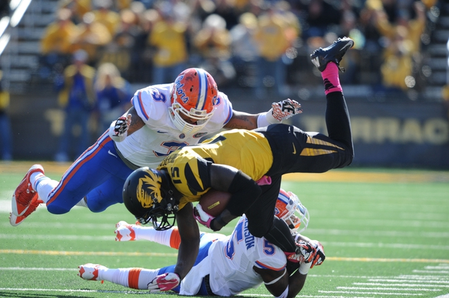 Oct 19, 2013; Columbia, MO, USA; Missouri Tigers wide receiver Dorial Green-Beckham (15) catches a pass and is tackled by Florida Gators defensive back Marcus Roberson (5) and Florida Gators linebacker Antonio Morrison (3) during the second half at Faurot Field. Missouri won 36-17. Mandatory Credit: Denny Medley-USA TODAY Sports