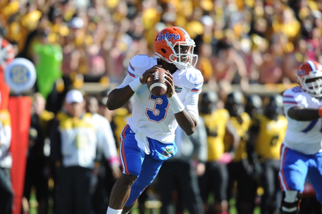 Oct 19, 2013; Columbia, MO, USA; Florida Gators quarterback Tyler Murphy (3) looks to pass during the second half of the game against the Missouri Tigers at Faurot Field. Missouri won 36-17. Mandatory Credit: Denny Medley-USA TODAY Sports