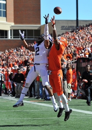 Oct 19, 2013; Stillwater, OK, USA; Texas Christian Horned Frogs defensive back Jason Verrett (2) brakes up a pass intended for  Oklahoma State Cowboys wide receiver Charlie Moore (17) during the second half at Boone Pickens Stadium. Oklahoma State won 24-10. Mandatory Credit: Peter G. Aiken-USA TODAY Sports