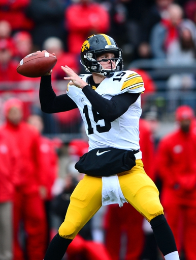 Oct 19, 2013; Columbus, OH, USA; Iowa Hawkeyes quarterback Jake Rudock (15) throws a pass during the second quarter against the Ohio State Buckeyes at Ohio Stadium. Mandatory Credit: Andrew Weber-USA TODAY Sports