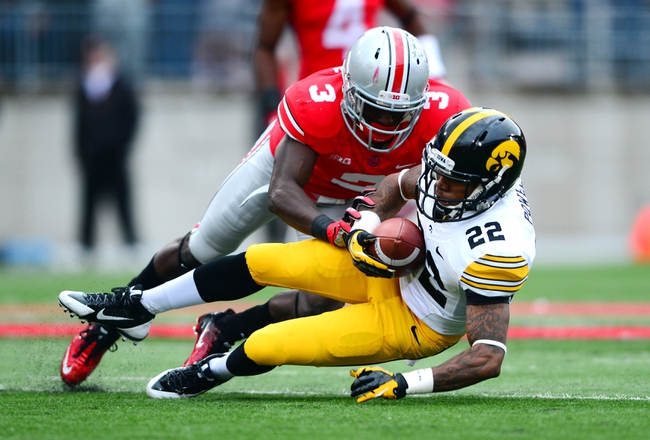 Oct 19, 2013; Columbus, OH, USA; Iowa Hawkeyes wide receiver Damond Powell (22) makes a catch while being defended by Ohio State Buckeyes defensive back Corey Brown (3) during the second quarter at Ohio Stadium. Mandatory Credit: Andrew Weber-USA TODAY Sports