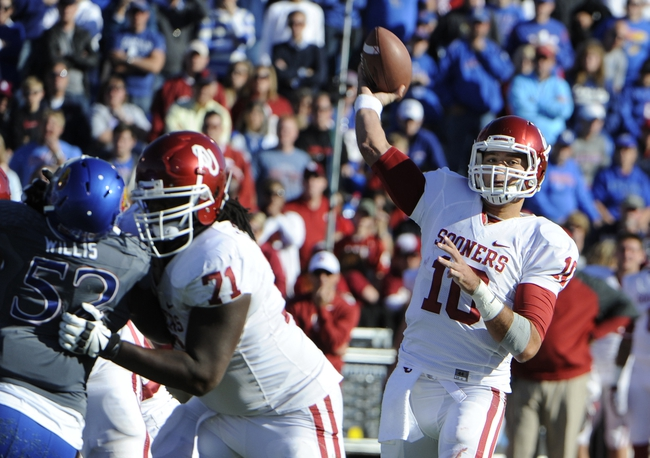 Oct 19, 2013; Lawrence, KS, USA; Oklahoma Sooners quarterback Blake Bell (10) drops back to pass against the Kansas Jayhawks in the first half at Memorial Stadium. Mandatory Credit: John Rieger-USA TODAY Sports