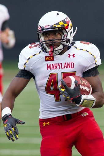 Oct 19, 2013; Winston-Salem, NC, USA; Maryland Terrapins running back Brandon Ross (45) runs the ball during the second quarter against the Wake Forest Demon Deacons at BB&T Field. Mandatory Credit: Jeremy Brevard-USA TODAY Sports