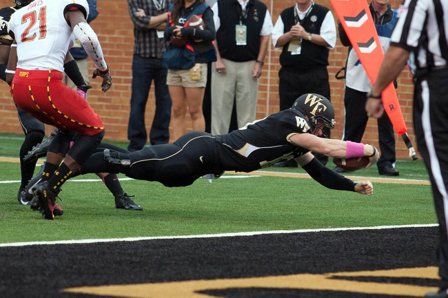 Oct 19, 2013; Winston-Salem, NC, USA; Wake Forest Demon Deacons quarterback Tanner Price (10) dives in for a touchdown during the second quarter against the Maryland Terrapins at BB&T Field. Mandatory Credit: Jeremy Brevard-USA TODAY Sports