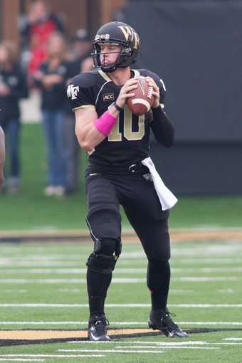 Oct 19, 2013; Winston-Salem, NC, USA; Wake Forest Demon Deacons quarterback Tanner Price (10) looks to pass the ball during the first quarter against the Maryland Terrapins at BB&T Field. Mandatory Credit: Jeremy Brevard-USA TODAY Sports