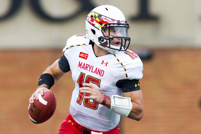 Oct 19, 2013; Winston-Salem, NC, USA; Maryland Terrapins quarterback C.J. Brown (16) rolls out of the pocket during the first quarter against the Wake Forest Demon Deacons at BB&T Field. Mandatory Credit: Jeremy Brevard-USA TODAY Sports