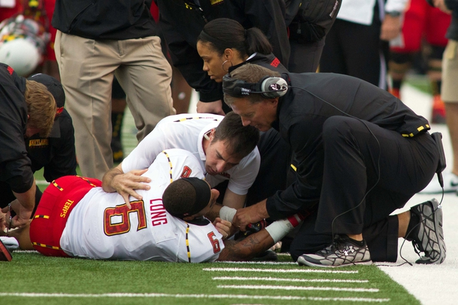 Oct 19, 2013; Winston-Salem, NC, USA; Maryland Terrapins head coach Randy Edsall talks with wide receiver Deon Long (6) after being injured during the second quarter against the Wake Forest Demon Deacons at BB&T Field. Mandatory Credit: Jeremy Brevard-USA TODAY Sports