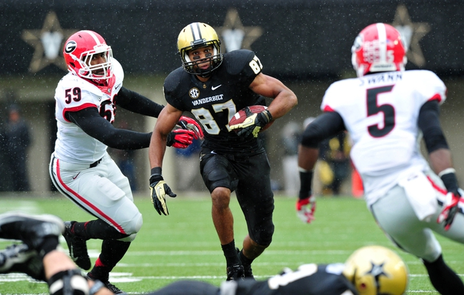 Oct 19, 2013; Nashville, TN, USA; Vanderbilt Commodores wide receiver Jordan Matthews (87) carries the ball against Georgia Bulldogs linebacker Jordan Jenkins (59) during the first half at Vanderbilt Stadium. The Commodores beat the Bulldogs 31-27. Mandatory Credit: Don McPeak-USA TODAY Sports