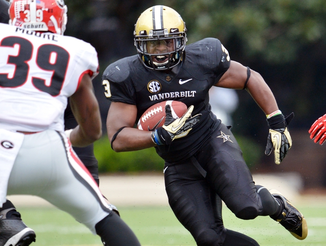 Oct 19, 2013; Nashville, TN, USA; Vanderbilt Commodores running back Jerron Seymour (3) carries the ball against Georgia Bulldogs safety Corey Moore (39) during the second half at Vanderbilt Stadium. The Commodores beat the Bulldogs 31-27. Mandatory Credit: Don McPeak-USA TODAY Sports