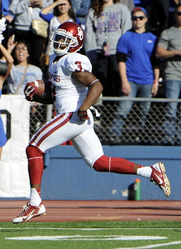 Oct 19, 2013; Lawrence, KS, USA; Oklahoma Sooners wide receiver Sterling Shepard (3) runs for a touchdown after a catch against the Kansas Jayhawks in the first half at Memorial Stadium. Mandatory Credit: John Rieger-USA TODAY Sports