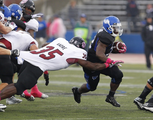 Oct 19, 2013; Buffalo, NY, USA; Massachusetts Minutemen defensive lineman Stanley Andre (35) dives to try and tackle Buffalo Bulls running back Branden Oliver (32) during the first half at University of Buffalo Stadium. Mandatory Credit: Timothy T. Ludwig-USA TODAY Sports
