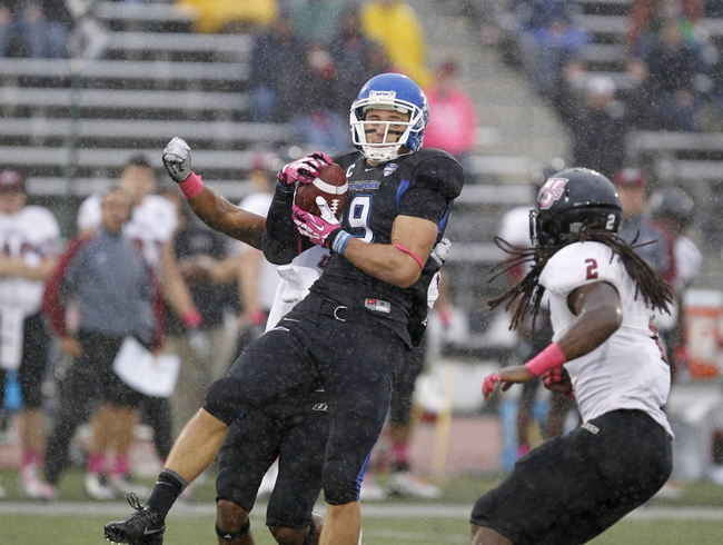 Oct 19, 2013; Buffalo, NY, USA; Buffalo Bulls wide receiver Alex Neutz (19) makes a catch during the first half against the Massachusetts Minutemen at University of Buffalo Stadium. Mandatory Credit: Timothy T. Ludwig-USA TODAY Sports
