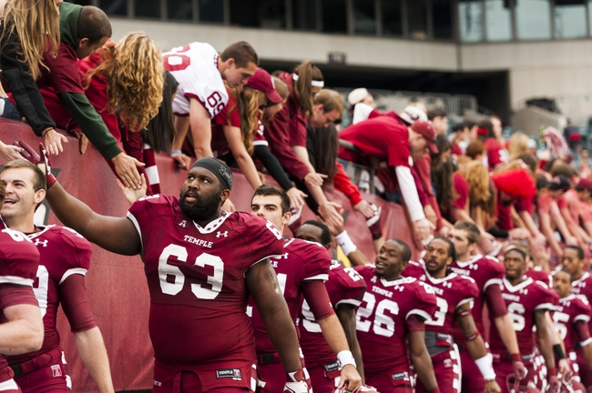 Oct 19, 2013; Philadelphia, PA, USA; Temple Owls players including offensive lineman Pete White (63) celebrate with fans after defeating the Army Black Knights at Lincoln Financial Field. Temple defeated Army 33-14. Mandatory Credit: Howard Smith-USA TODAY Sports