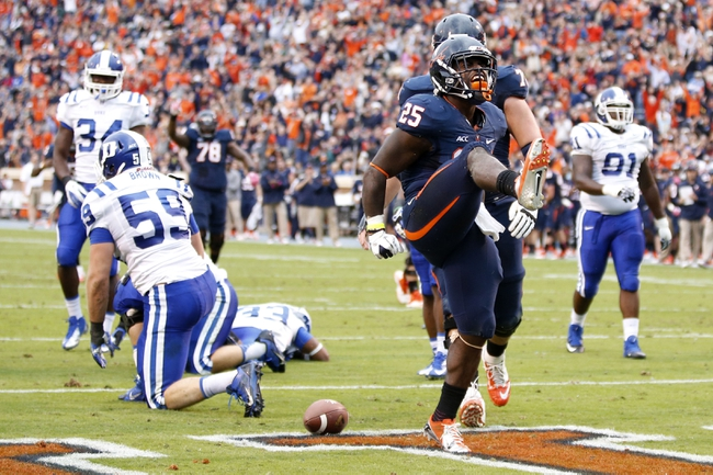 Oct 19, 2013; Charlottesville, VA, USA;  Virginia Cavaliers running back Kevin Parks (25) celebrates after scoring a touchdown against the Duke Blue Devils in the second quarter at Scott Stadium. Mandatory Credit: Geoff Burke-USA TODAY Sports