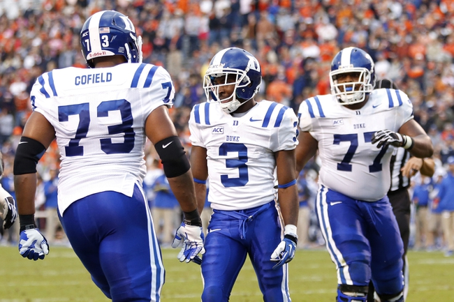 Oct 19, 2013; Charlottesville, VA, USA; Duke Blue Devils wide receiver Jamison Crowder (3) celebrates with teammates after scoring a touchdown against the Virginia Cavaliers in the second quarter  at Scott Stadium. Mandatory Credit: Geoff Burke-USA TODAY Sports