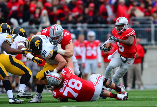 Oct 19, 2013; Columbus, OH, USA; Ohio State Buckeyes quarterback Braxton Miller (5) runs the ball during the third quarter against the Iowa Hawkeyes at Ohio Stadium. Mandatory Credit: Andrew Weber-USA TODAY Sports