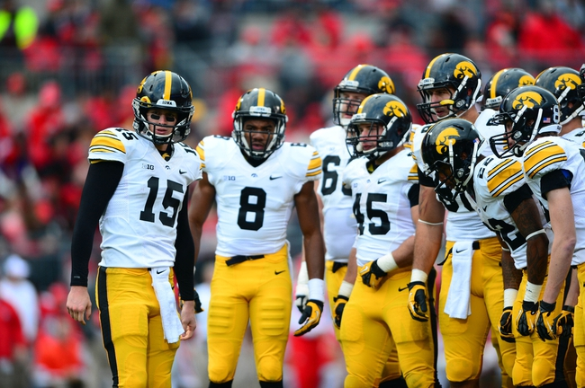 Oct 19, 2013; Columbus, OH, USA; Iowa Hawkeyes quarterback Jake Rudock (15) huddles during the third quarter against the Ohio State Buckeyes at Ohio Stadium. Mandatory Credit: Andrew Weber-USA TODAY Sports