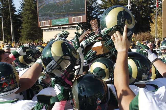 Oct 19, 2013; Laramie, WY, USA; The Colorado State Rams celebrate with the Bronze Boot Trophy after the border war with the Wyoming Cowboys at War Memorial Stadium. The Rams defeated the Cowboys 52-22.   Mandatory Credit: Troy Babbitt-USA TODAY Sports