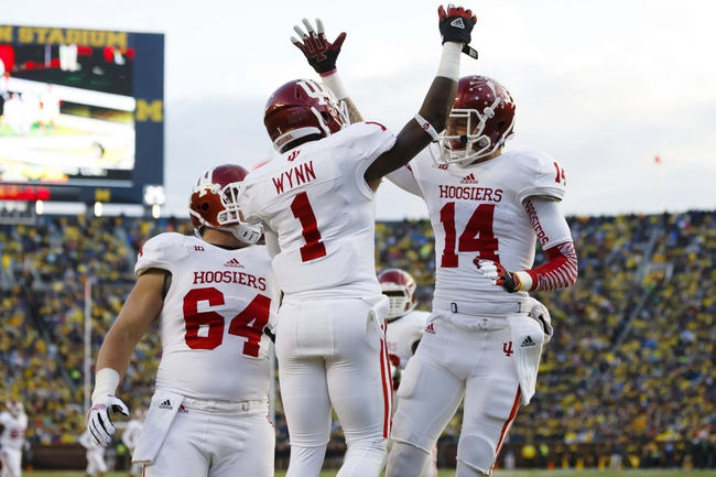 Oct 19, 2013; Ann Arbor, MI, USA; Indiana Hoosiers wide receiver Shane Wynn (1) wide receiver Nick Stoner (14) and center Collin Rahrig (64) celebrate a touchdown in the third quarter  against the Michigan Wolverines at Michigan Stadium. Mandatory Credit: Rick Osentoski-USA TODAY Sports