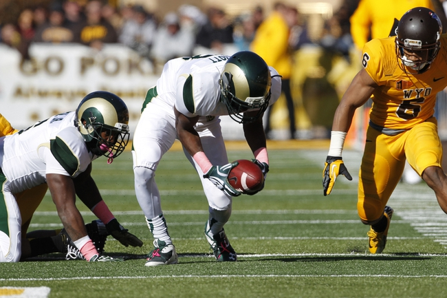 Oct 19, 2013; Laramie, WY, USA; Colorado State Rams defensive back Elliott DeAndre (13) picks up a fumble and runs against Wyoming Cowboys wide receiver Robert Herron (6) during the fourth quarter at War Memorial Stadium. The Rams defeated the Cowboys 52-22.   Mandatory Credit: Troy Babbitt-USA TODAY Sports