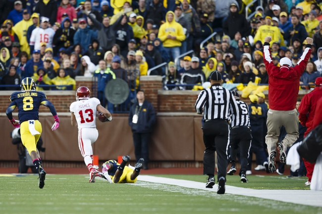 Oct 19, 2013; Ann Arbor, MI, USA; Indiana Hoosiers wide receiver Kofi Hughes (13) runs the ball in for a touchdown Michigan Wolverines defensive back Channing Stribling (8) runs after him in the third quarter at Michigan Stadium. Mandatory Credit: Rick Osentoski-USA TODAY Sports