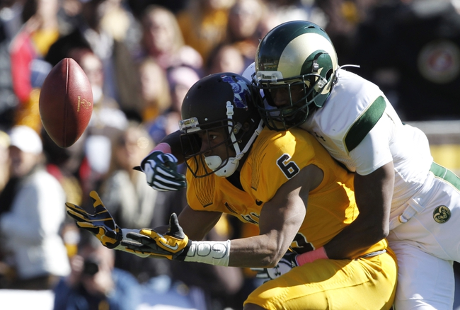 Oct 19, 2013; Laramie, WY, USA; Colorado State Rams defensive back Elliott DeAndre (13) breaks up a pass against Wyoming Cowboys wide receiver Robert Herron (6) during the third quarter at War Memorial Stadium. The Rams defeated the Cowboys 52-22.   Mandatory Credit: Troy Babbitt-USA TODAY Sports