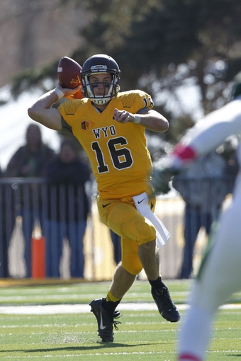 Oct 19, 2013; Laramie, WY, USA; Wyoming Cowboys quarterback Brett Smith (16) looks to throw against the Colorado State Rams during the third quarter at War Memorial Stadium. The Rams defeated the Cowboys 52-22.   Mandatory Credit: Troy Babbitt-USA TODAY Sports