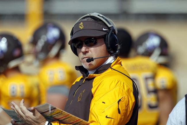 Oct 19, 2013; Laramie, WY, USA; Wyoming Cowboys head coach Dave Christensen during game against the Colorado State Rams at War Memorial Stadium. The Rams defeated the Cowboys 52-22.   Mandatory Credit: Troy Babbitt-USA TODAY Sports