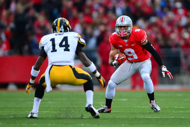 Oct 19, 2013; Columbus, OH, USA; Ohio State Buckeyes wide receiver Devin Smith (9) looks to get around Iowa Hawkeyes defensive back Desmond King (14) during the fourth quarter at Ohio Stadium. Mandatory Credit: Andrew Weber-USA TODAY Sports