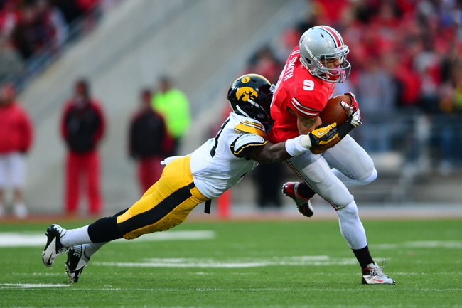 Oct 19, 2013; Columbus, OH, USA; Ohio State Buckeyes wide receiver Devin Smith (9) is tackled by Iowa Hawkeyes defensive back Desmond King (14) during the fourth quarter at Ohio Stadium. Mandatory Credit: Andrew Weber-USA TODAY Sports