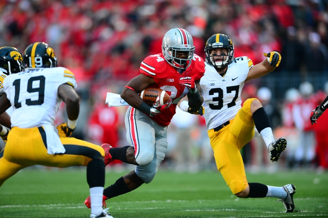 Oct 19, 2013; Columbus, OH, USA; Ohio State Buckeyes running back Carlos Hyde (34) runs the ball during the fourth quarter against the Iowa Hawkeyes at Ohio Stadium. Mandatory Credit: Andrew Weber-USA TODAY Sports