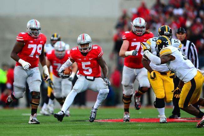 Oct 19, 2013; Columbus, OH, USA; Ohio State Buckeyes quarterback Braxton Miller (5) scrambles out of the pocket during the fourth quarter against the Iowa Hawkeyes at Ohio Stadium. Mandatory Credit: Andrew Weber-USA TODAY Sports