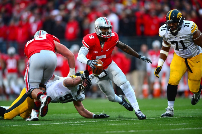 Oct 19, 2013; Columbus, OH, USA; Ohio State Buckeyes quarterback Braxton Miller (5) runs the ball during the fourth quarter against the Iowa Hawkeyes at Ohio Stadium. Mandatory Credit: Andrew Weber-USA TODAY Sports