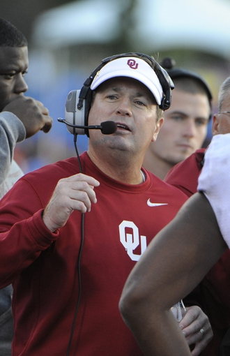 Oct 19, 2013; Lawrence, KS, USA; Oklahoma Sooners head coach Bob Stoops on the sidelines against the Kansas Jayhawks in the second half at Memorial Stadium. Oklahoma won the game 34-19. Mandatory Credit: John Rieger-USA TODAY Sports